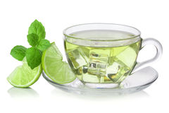 cold-green-tea-ice-cubes-lime-sliced-mint-leaves-32476617